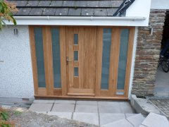 oak door with viewing panels and sidelights