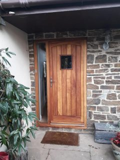 Curved head Iroko door