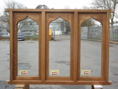 traditional hand crafted arched curved casement window