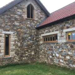 arched traditional oak wooden flush casement window